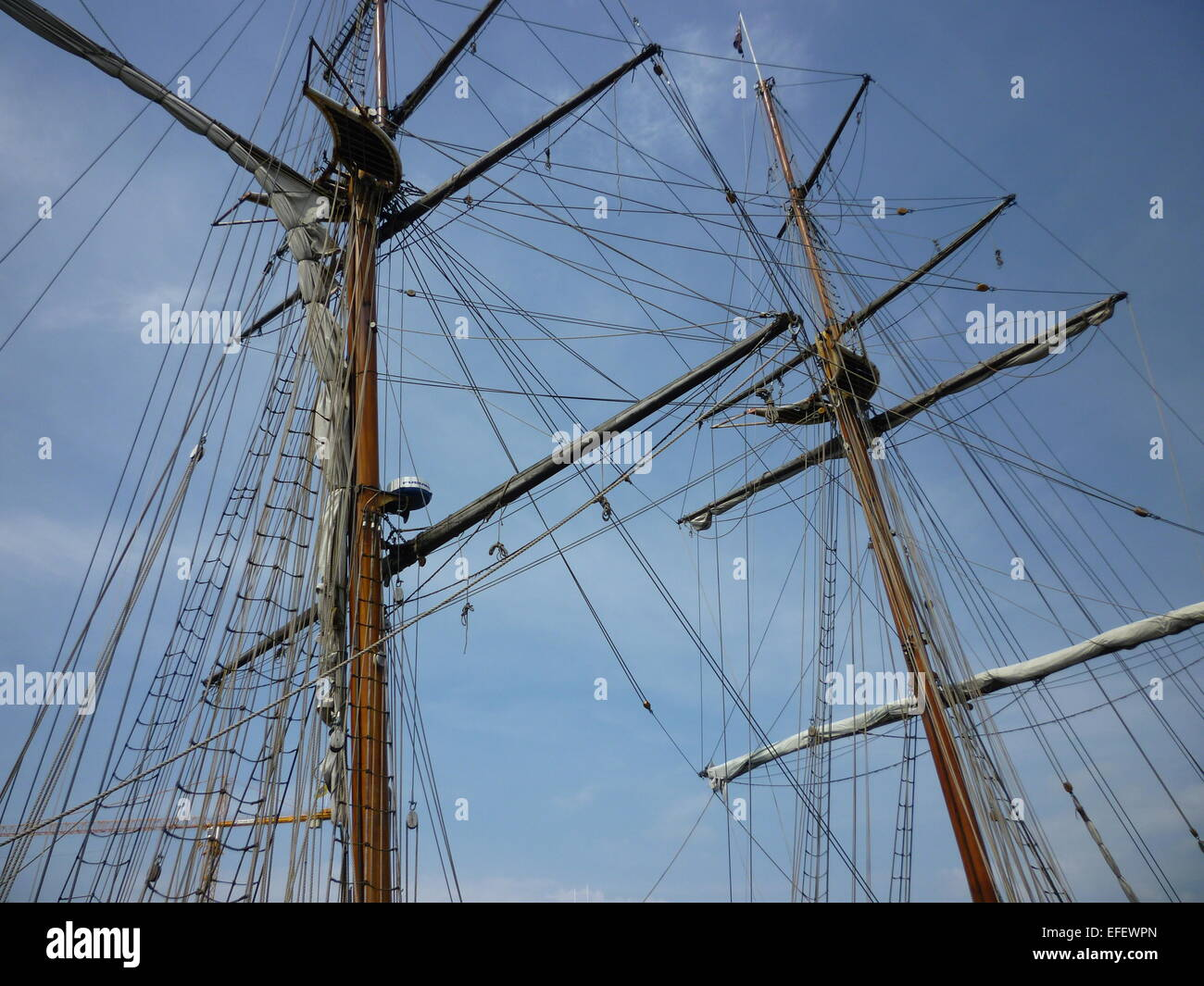 Rigging and blue skies - Stock Image