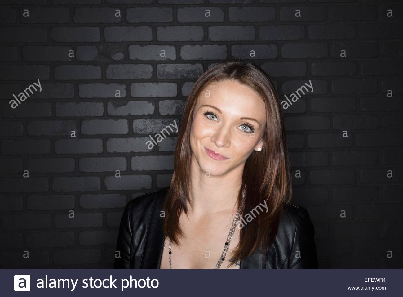 Portrait of brunette making a face - Stock Image