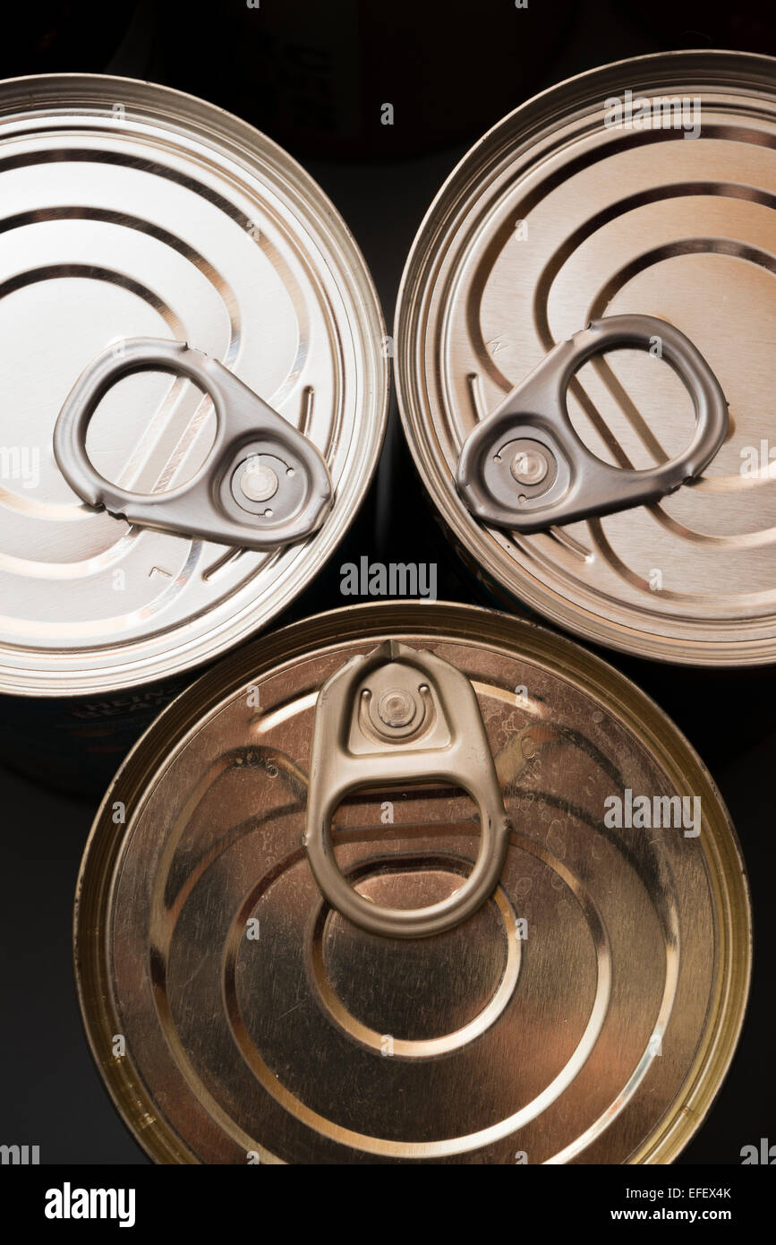 Tin cans with ring pulls from above - Stock Image