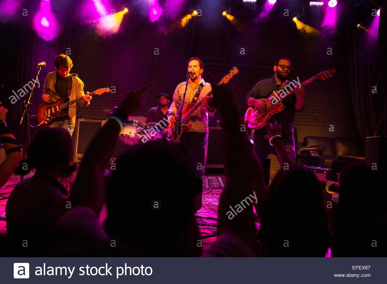 Musical performers on stage at music concert - Stock Image