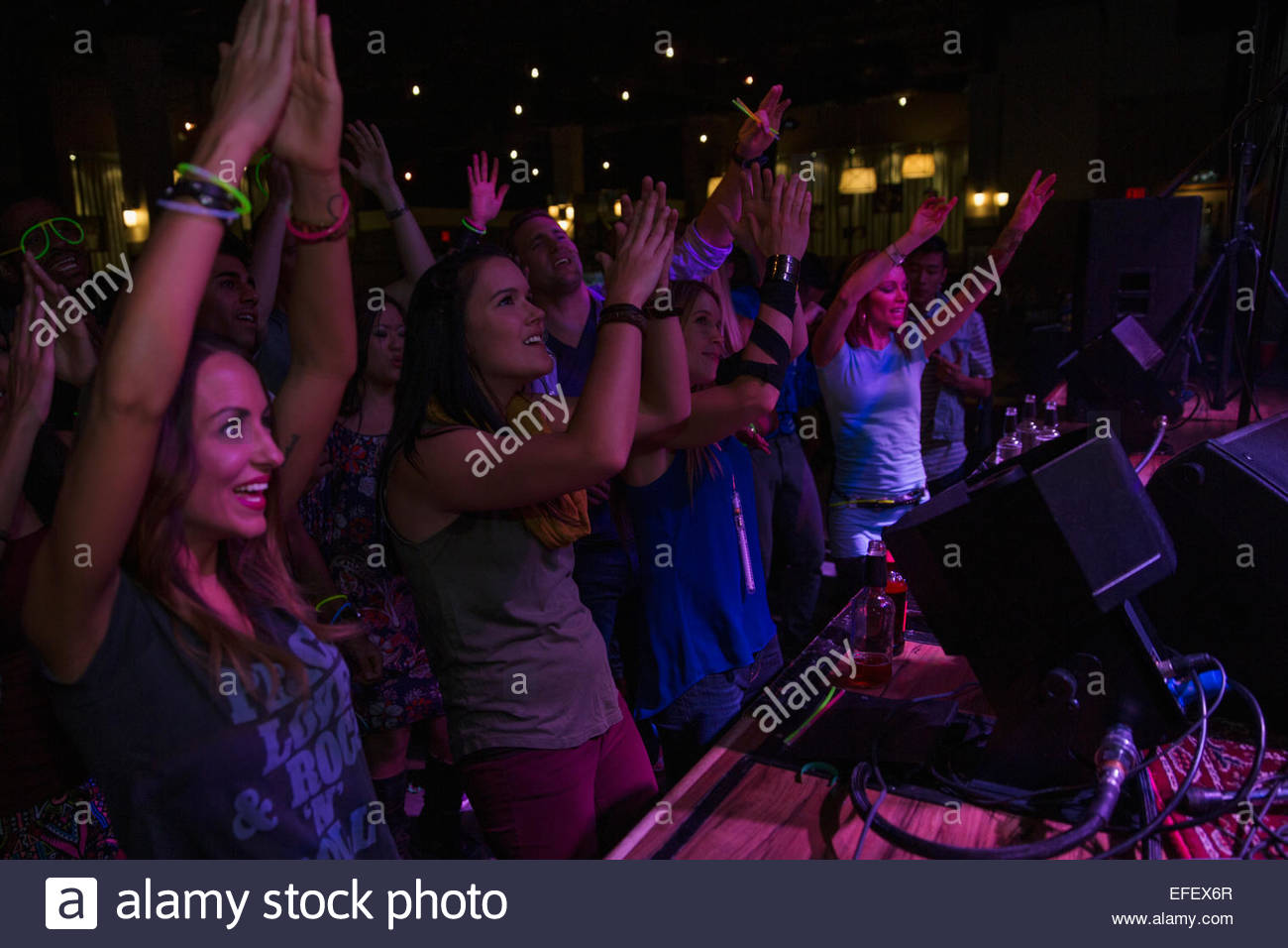 Crowd cheering at music concert - Stock Image