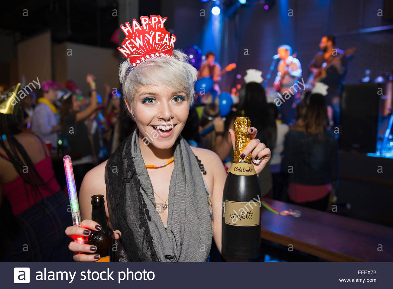 Portrait of woman with champagne celebrating New Year - Stock Image