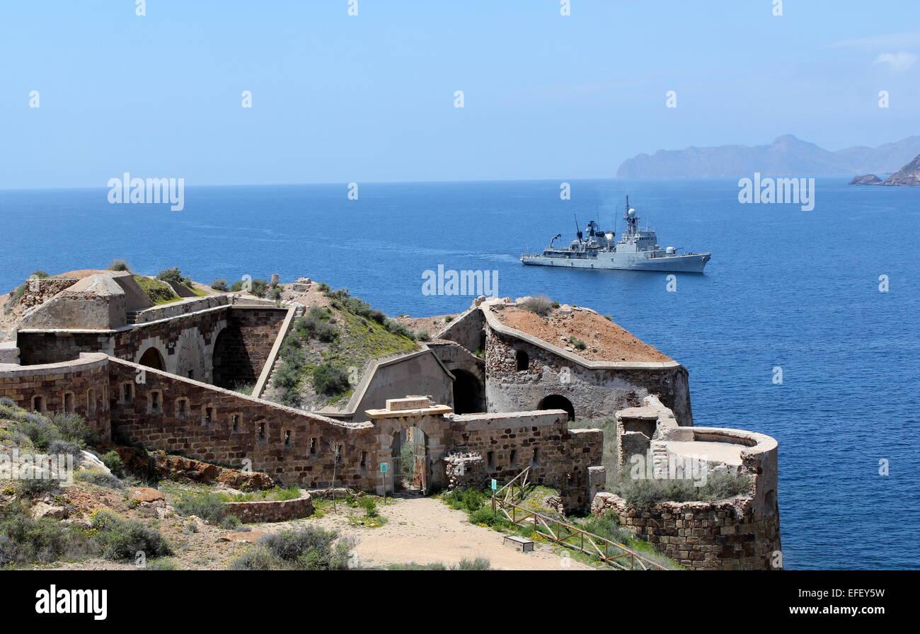 spanish naval vessel sailing into cartagena naval base in murcia