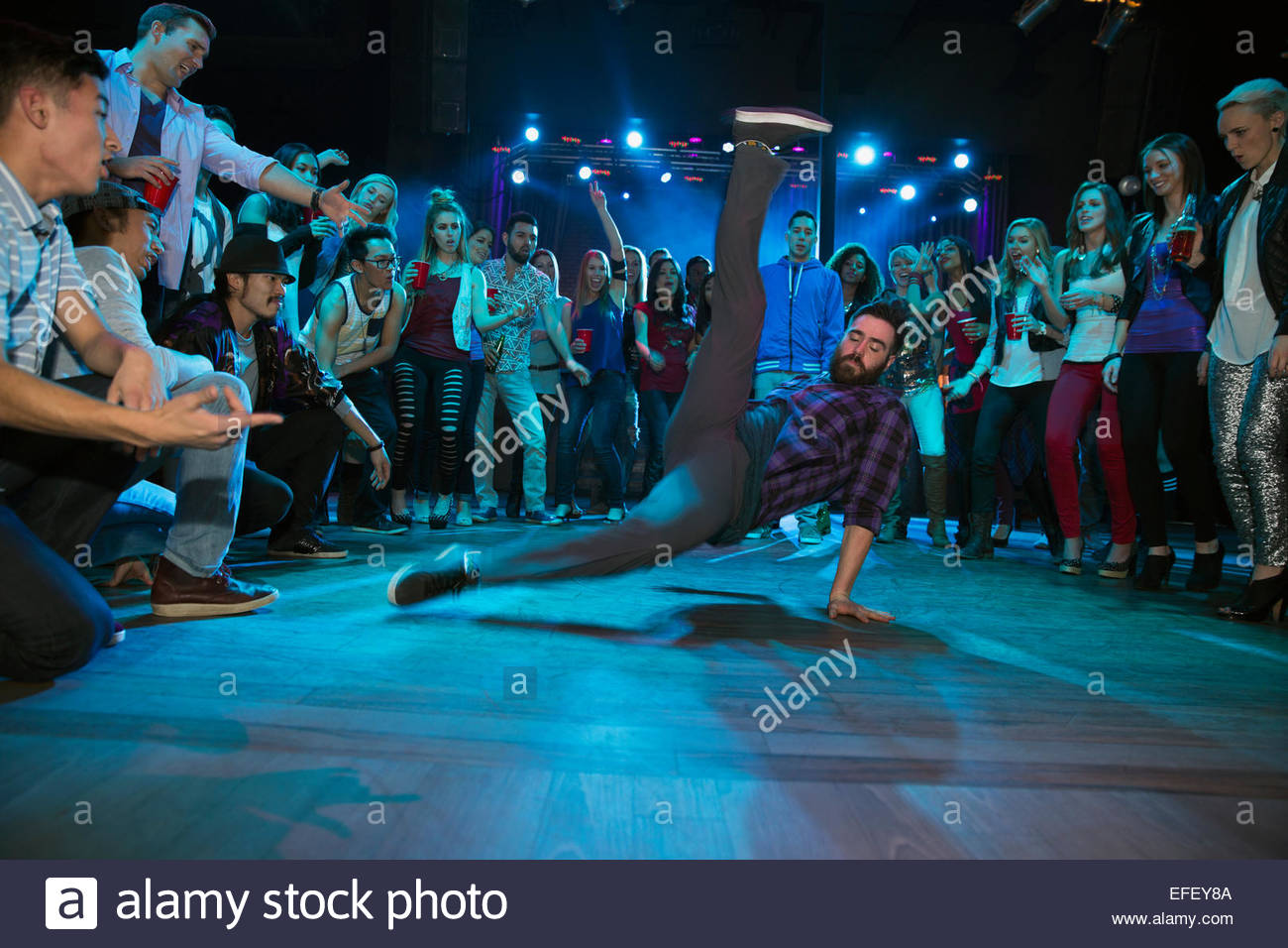 Crowd watching and cheering break dancers Stock Photo
