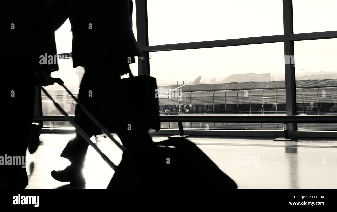 Airport Business Passenger Silhouette. - Stock Image