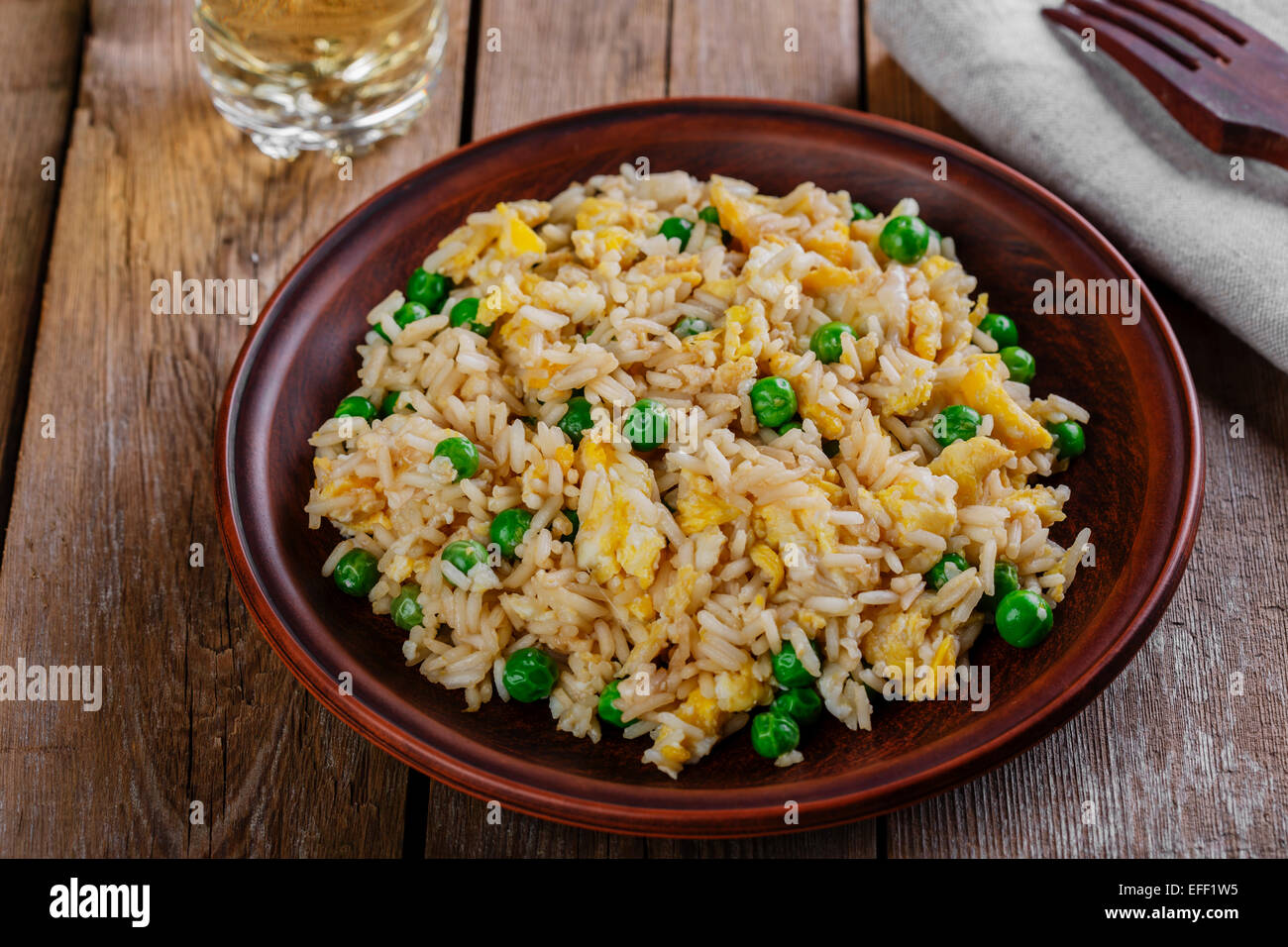 fried rice with egg and peas - Stock Image