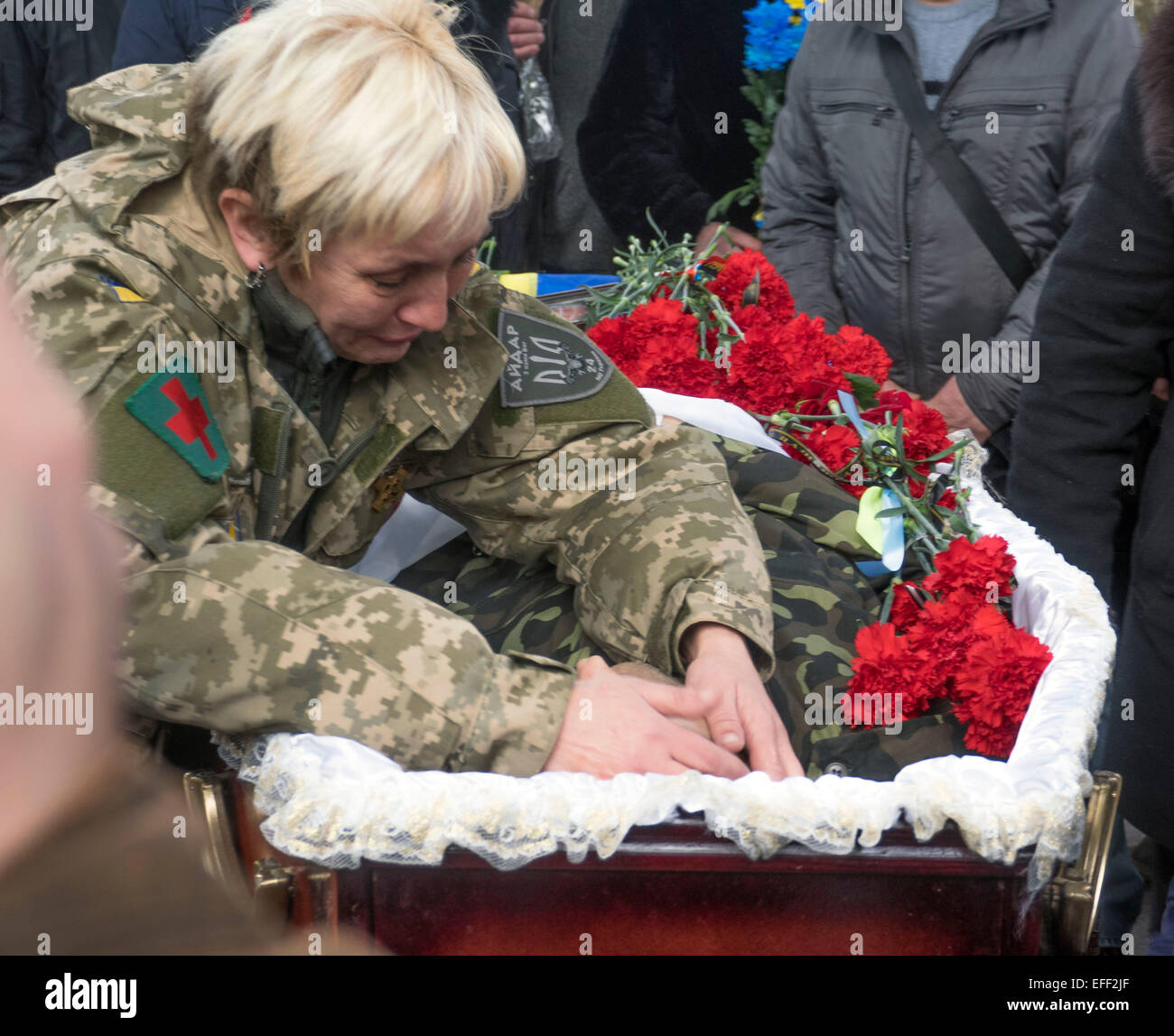 Kiev, Ukraine. 02nd Feb, 2015. Servicewomen of the Ukrainian volunteer battallion Aydar mourns next to the coffin - Stock Image