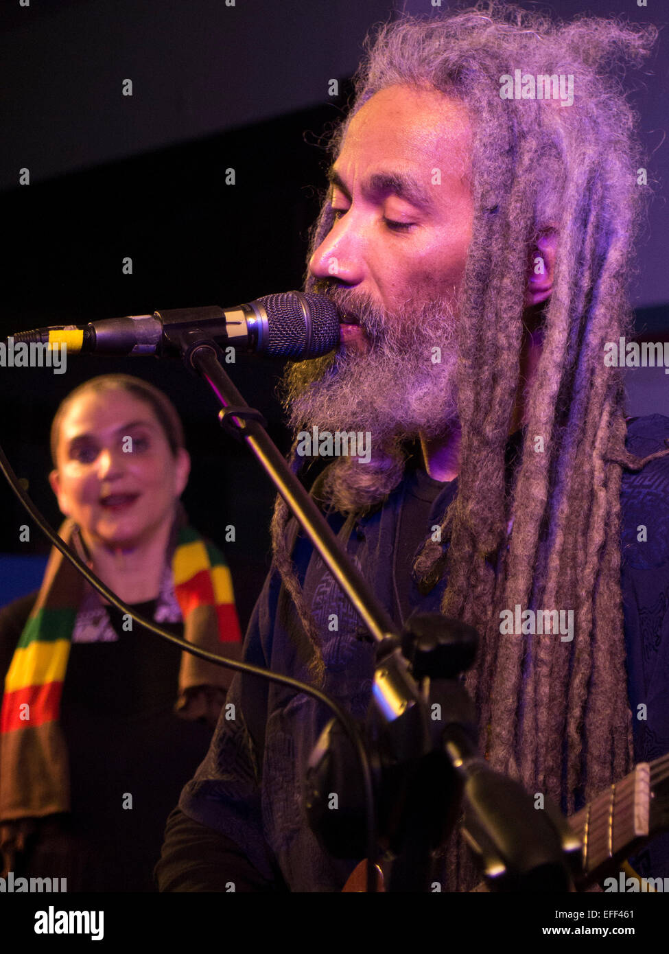 African American reggae musician sings with his Caucasian wife in their family band ReBelle, Northampton, MA, New - Stock Image