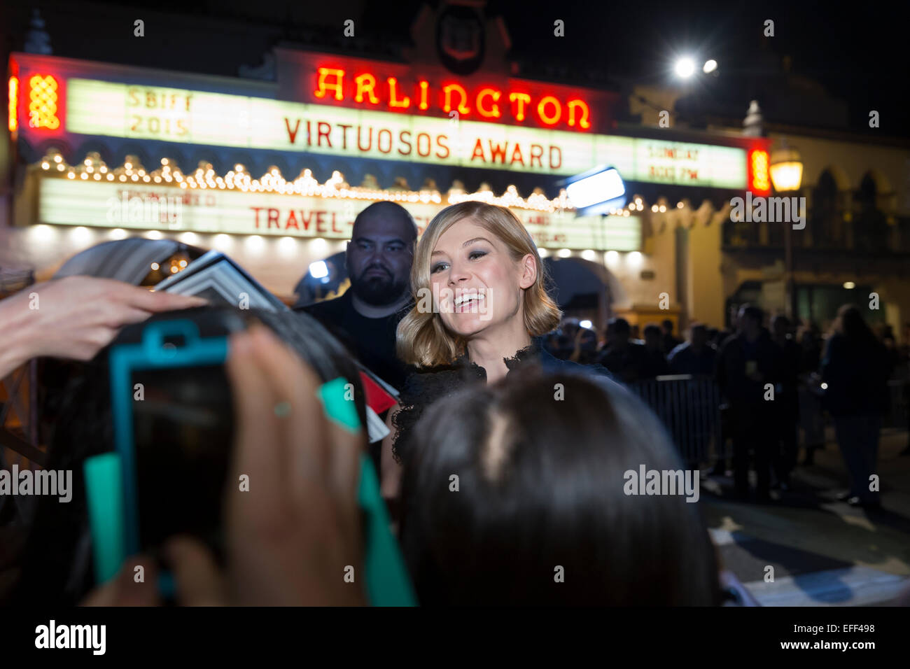 Santa Barbara, California, USA. 1st Feb, 2015. Fans clamor around actress Rosamund Pike hoping for an autograph - Stock Image