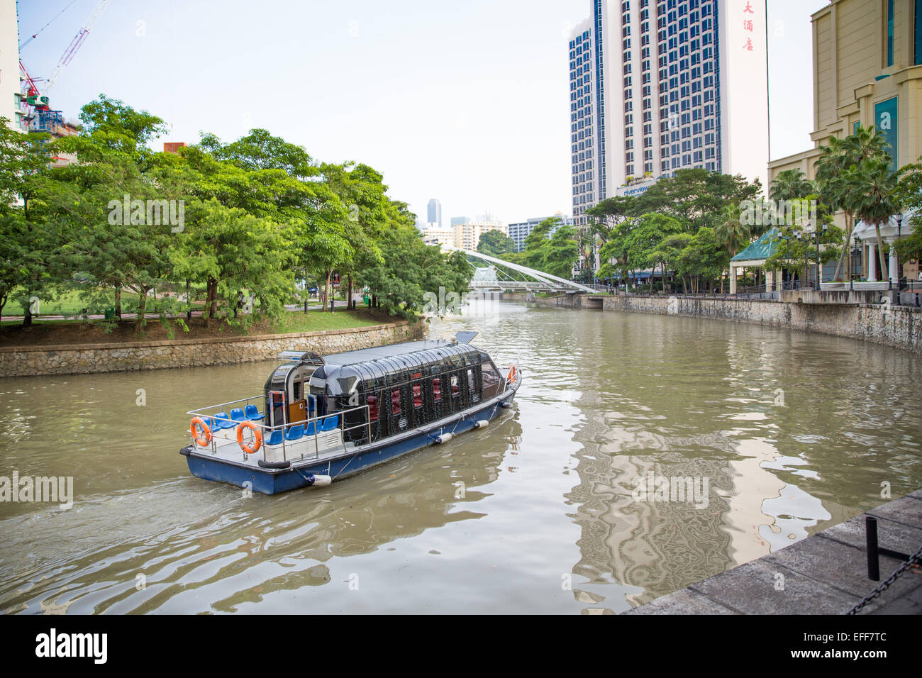 A tourist water taxi boat on Singapore River Stock Photo