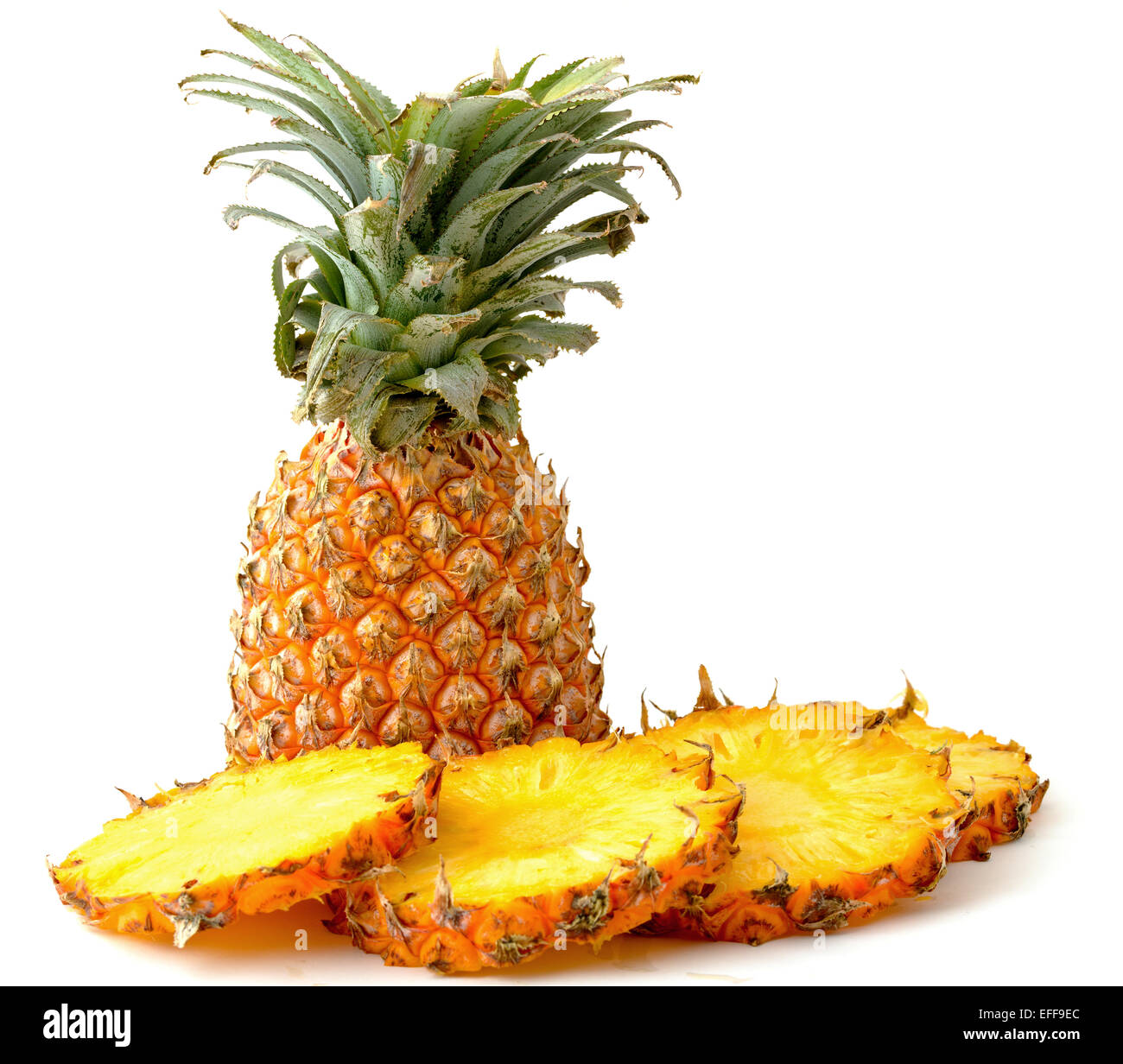 Pineapple and slices isolated - Stock Image