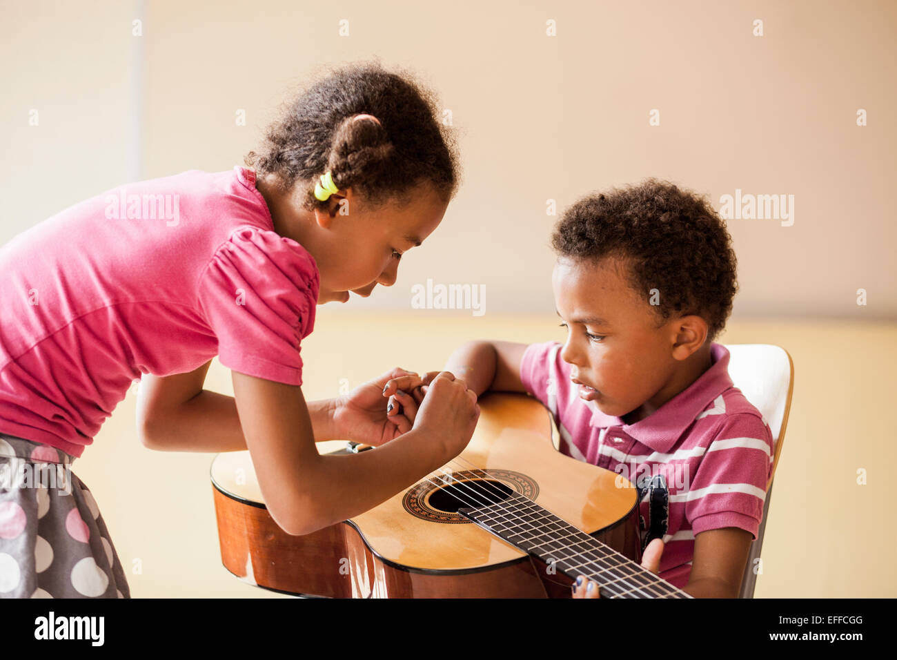 how to teach a child to play guitar