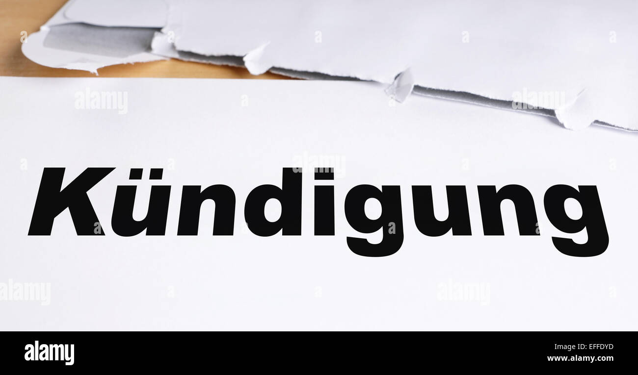 Kündigung german termination letter with opened envelope on desk - Stock Image