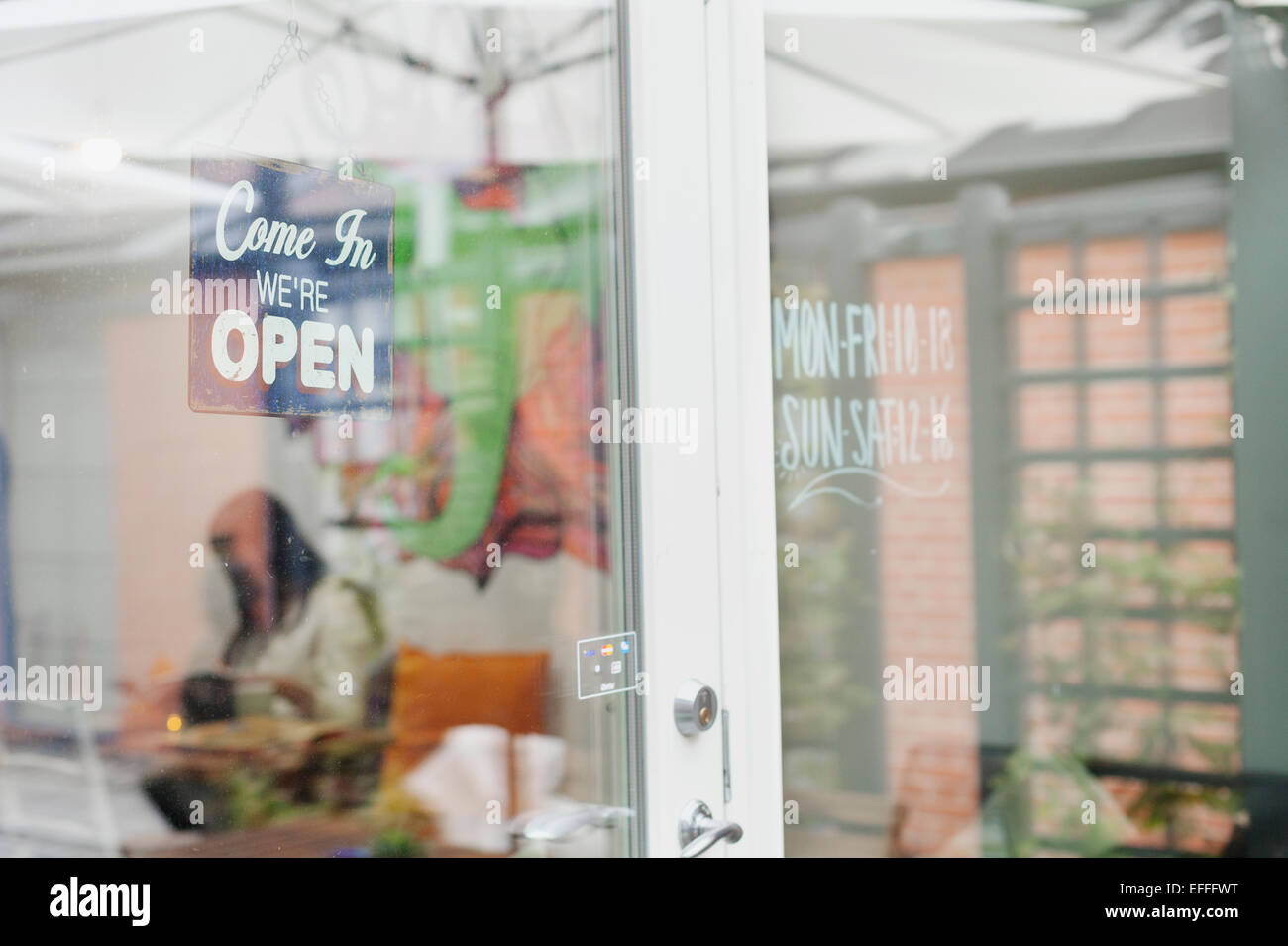 Open sign hanging on entrance of cafeteria Stock Photo