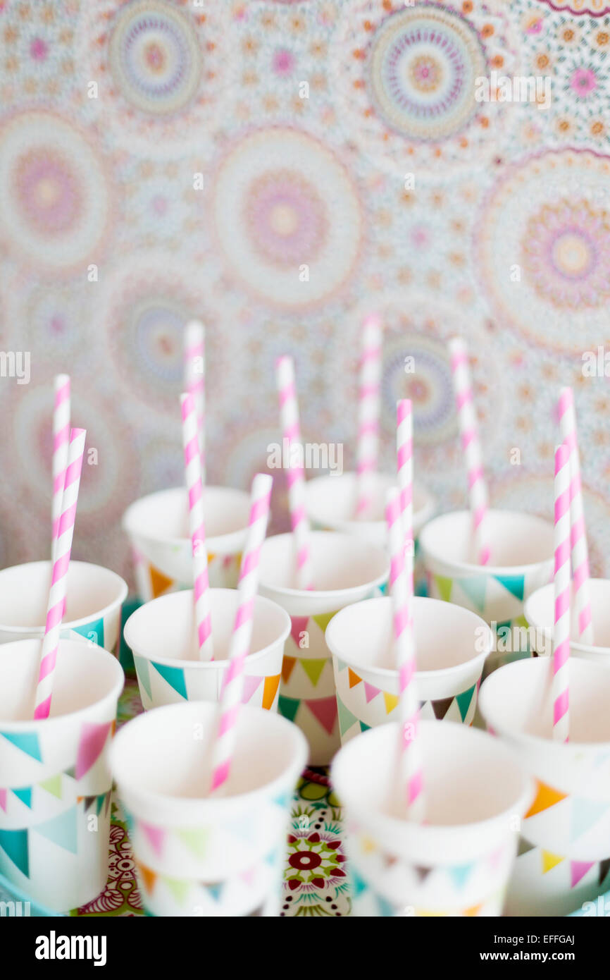 Striped cake pop sticks in cups - Stock Image