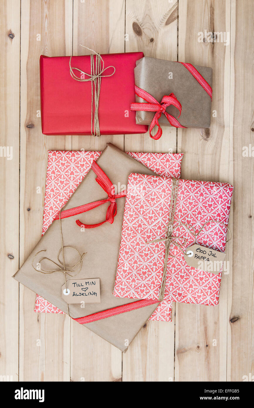 Christmas gift packages on wooden floor & Christmas gift packages on wooden floor Stock Photo: 78403449 - Alamy