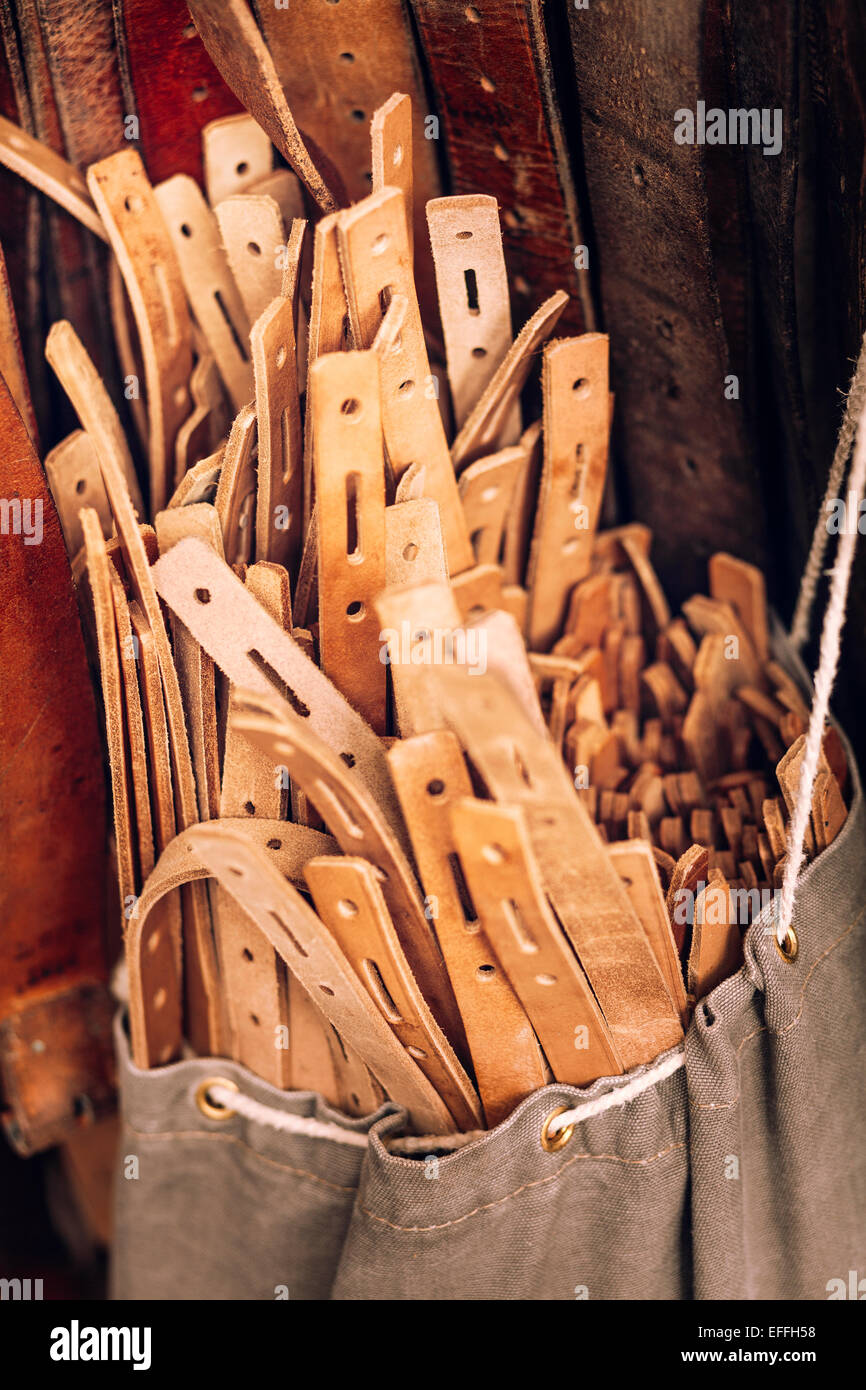 Close-up of leather belts in bag - Stock Image