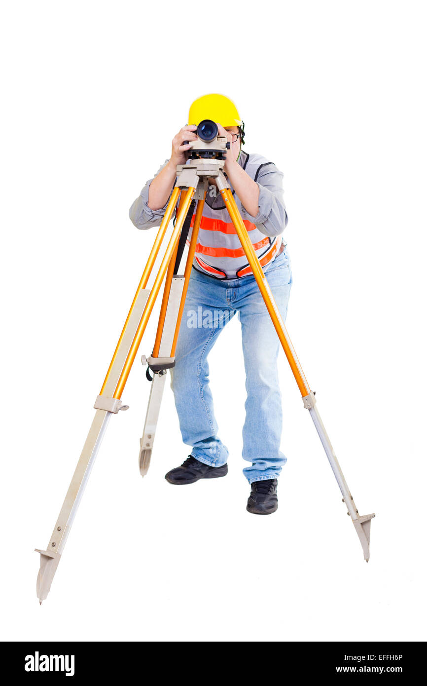 Surveyor worker making measurement  and isolated on white - Stock Image