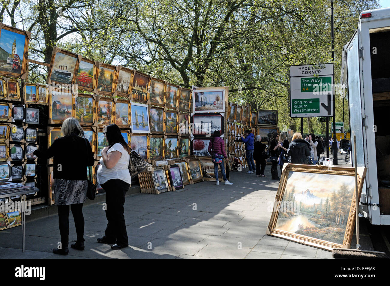People Looking At Paintings For Sale In Street Piccadilly London