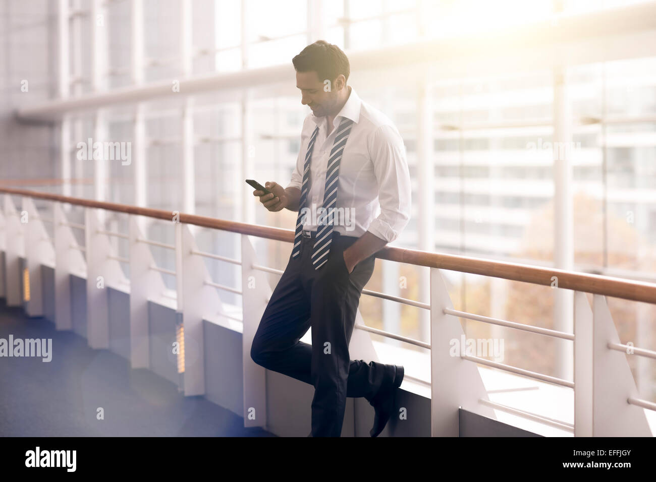 Portrait of a businessman relaxing - Stock Image
