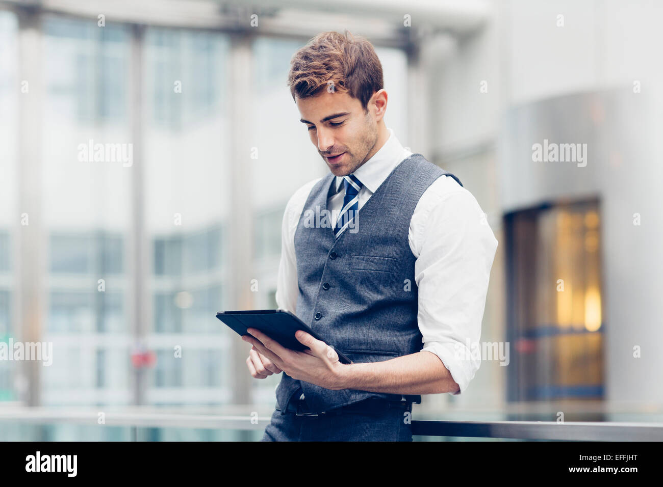 Portrait of a businessman working - Stock Image