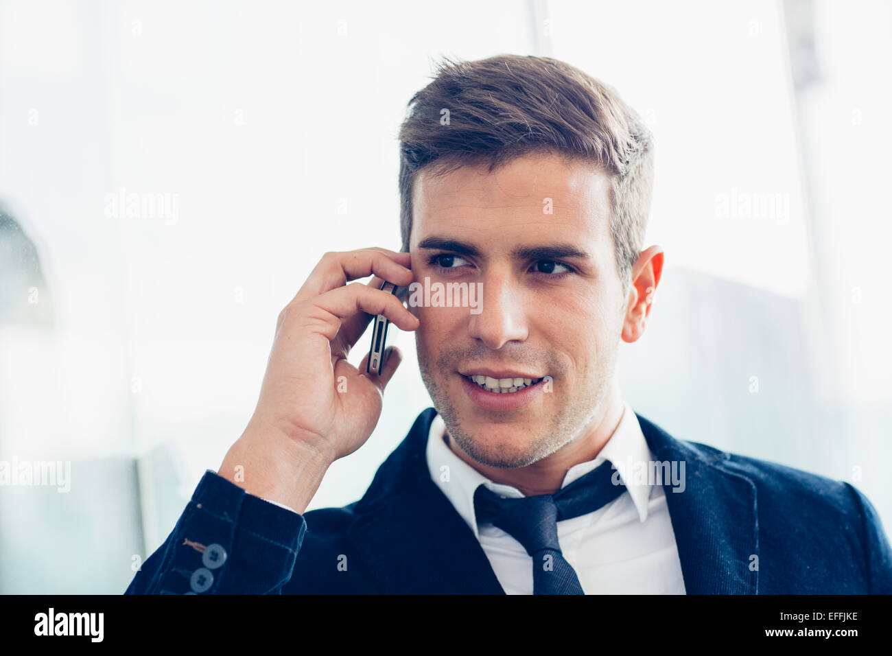 Businessman using a mobile phone - Stock Image