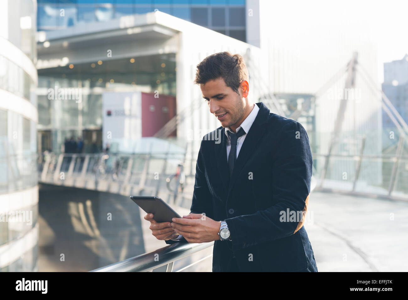 Businessman using a digital tablet - Stock Image