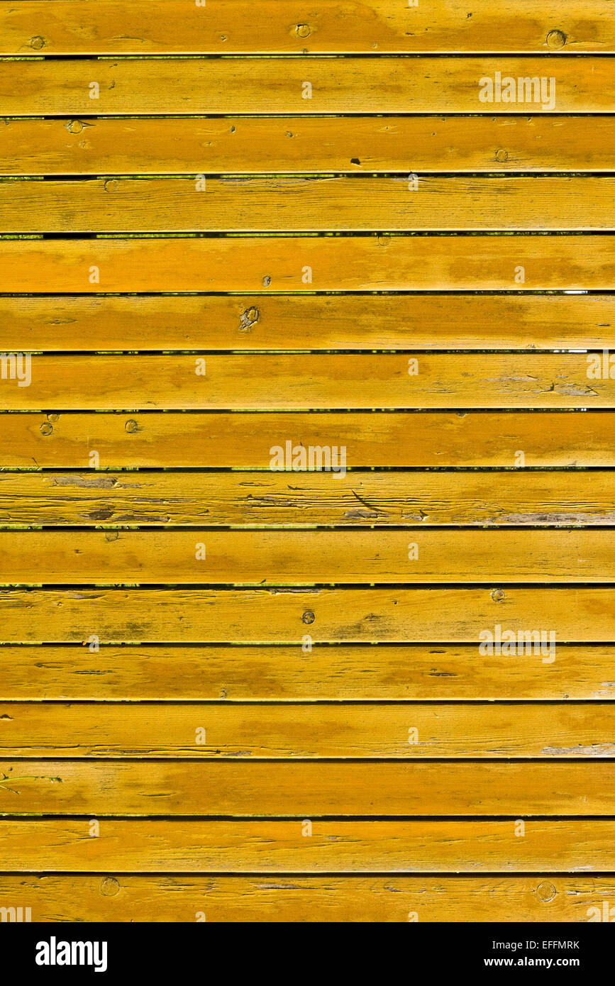 yellow wooden planks fence - Stock Image