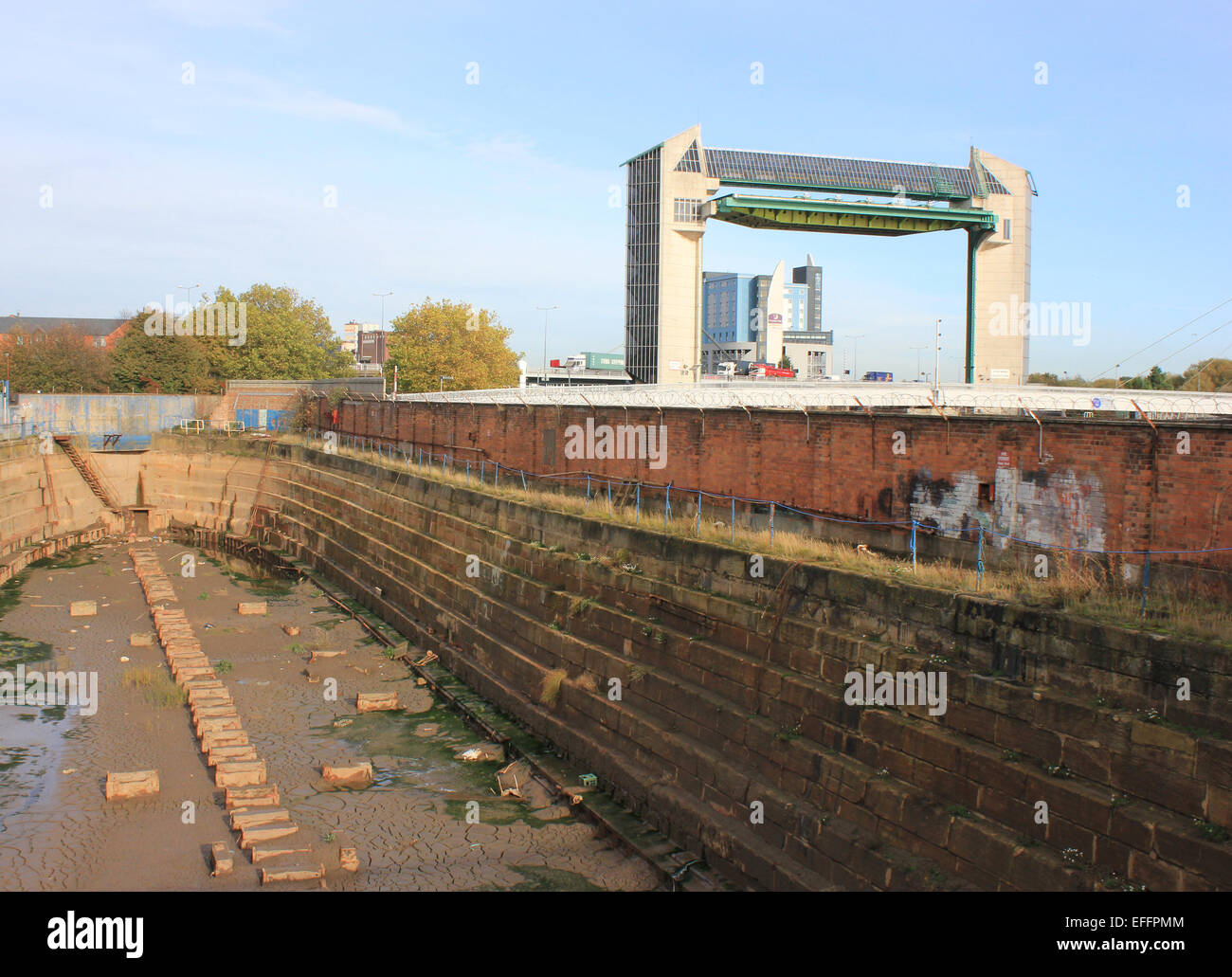 the hull tidal barrier rises above the central dry dock a graving
