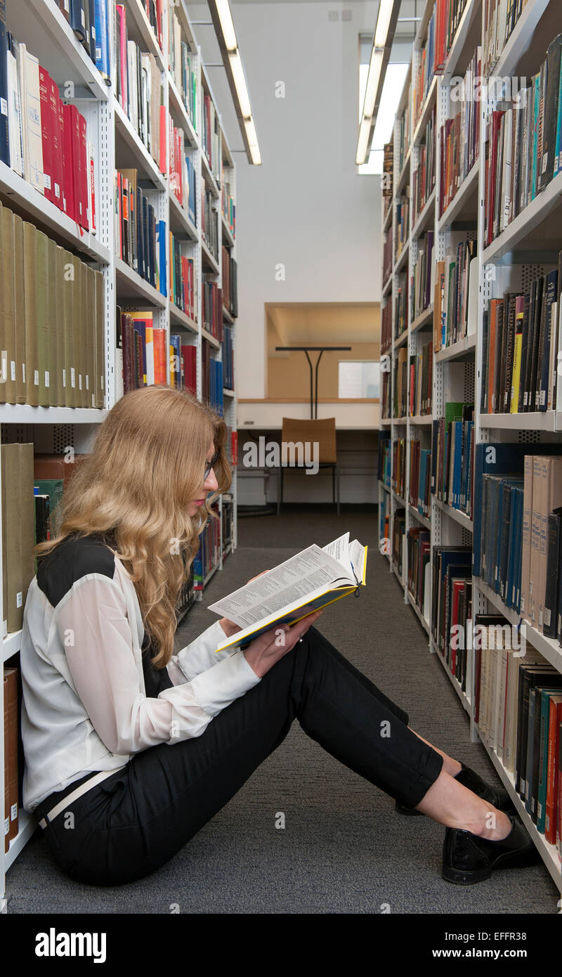 stacked short haircuts bookworm stock photos amp bookworm stock images alamy 1828 | a student a young woman with long hair and glasses sits by herself EFFR38