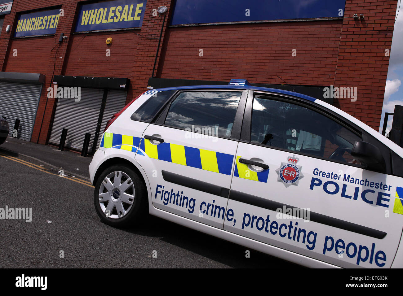 Greater Manchester Police car parked outside a clothes Wholesale warehouse in Manchester - Stock Image