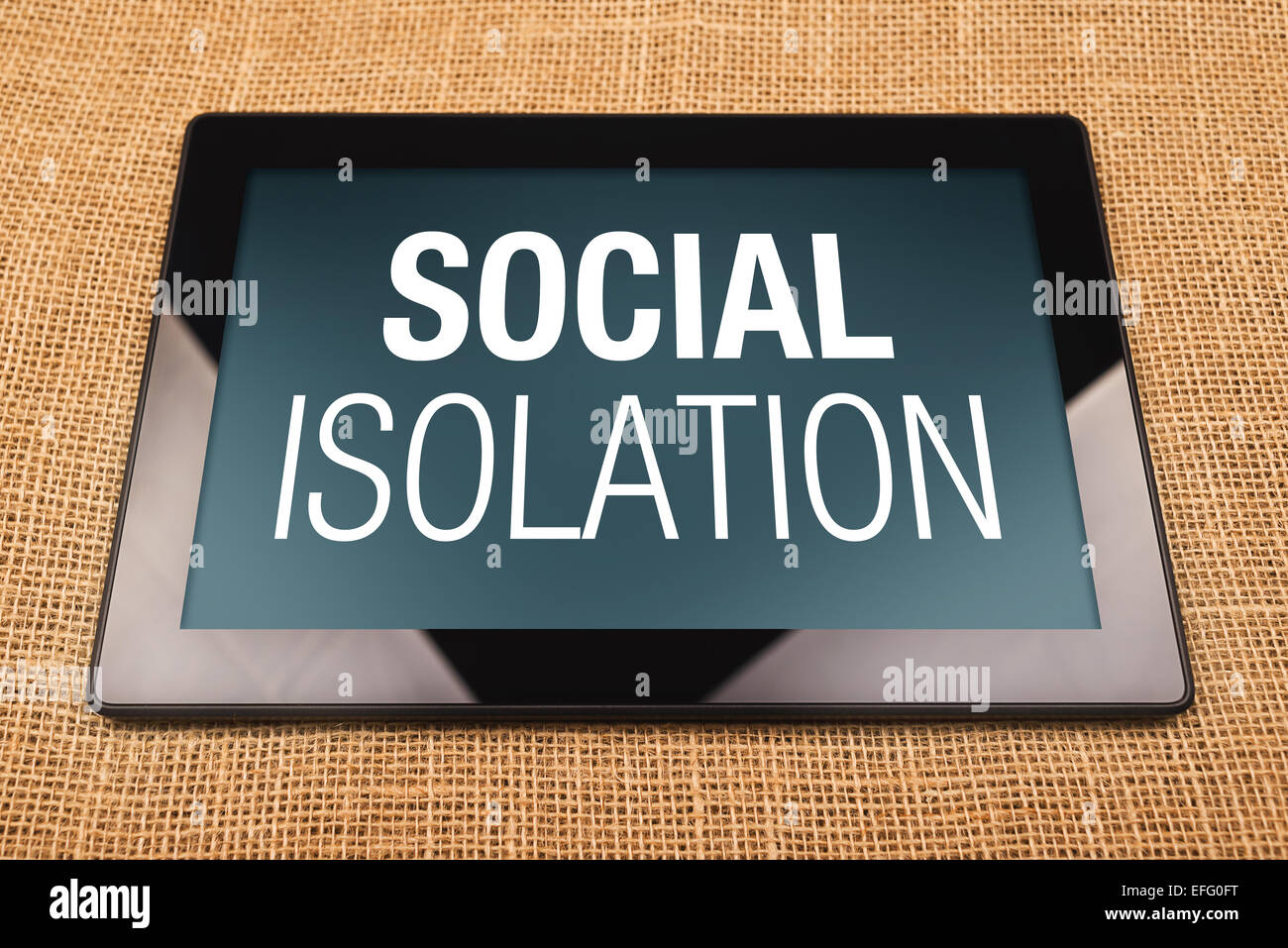 Digital Tablet Computer with Social Isolation displayed on the screen. - Stock Image