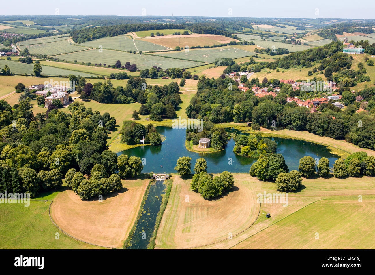 Aerial view of West Wycombe Park stately home and lake in rural landscape, Buckinghamshire, England - Stock Image