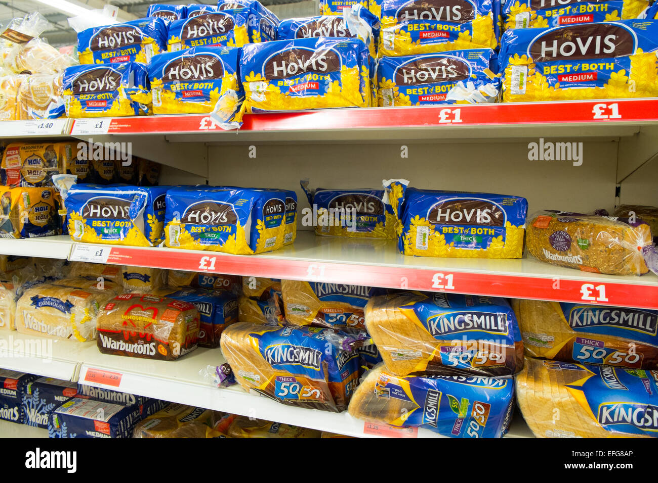hovis and kingsmill bread for sale at a uk sainsbury's supermarket - Stock Image