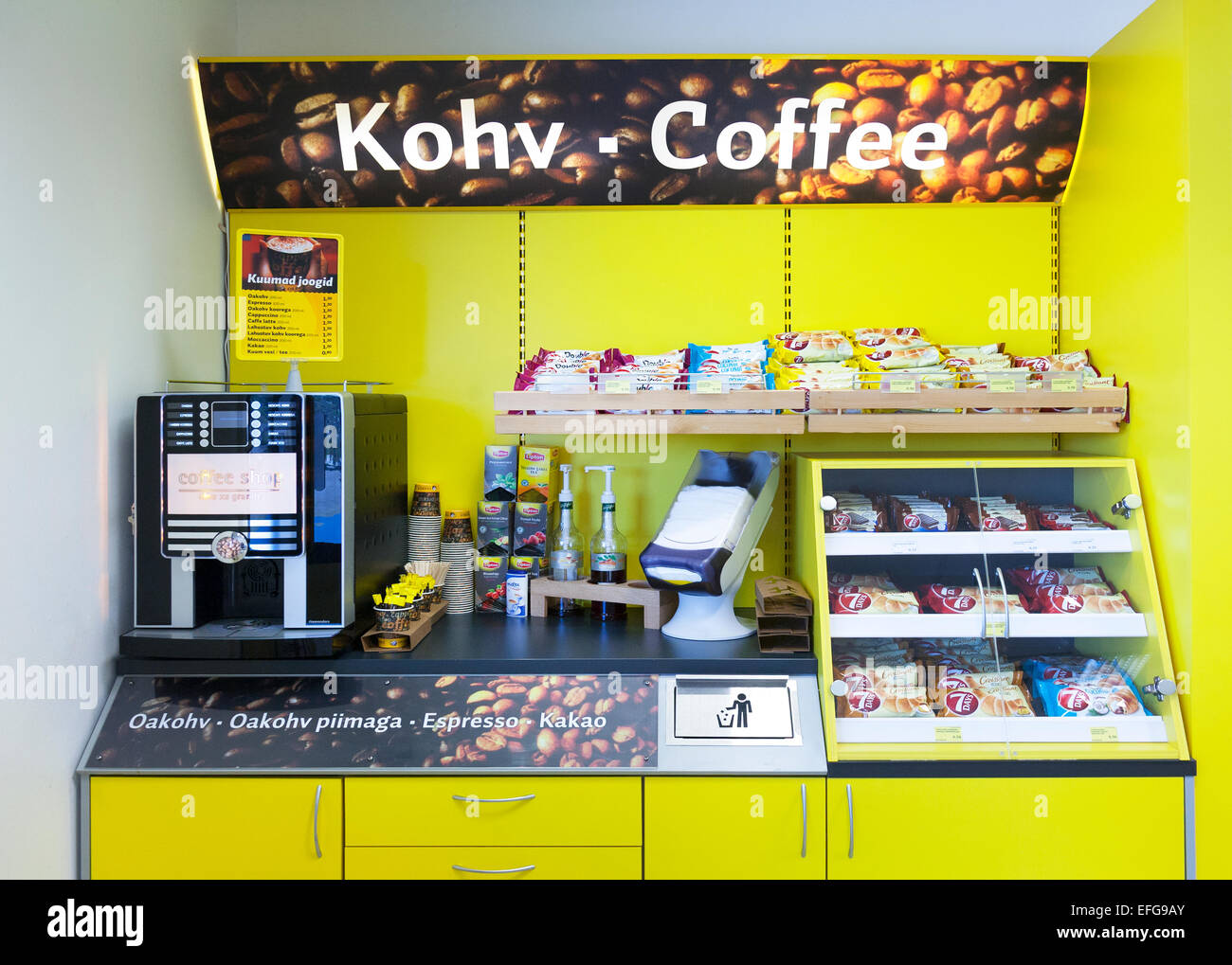 Gas station shop with coffee maker, shelves and food in Estonia. Coffee machine and fast food. Snacks. Furniture. - Stock Image