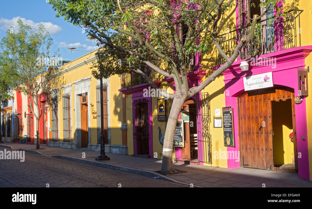 Oaxaca, Mexico - Colorfully painted stores and restaurants. - Stock Image