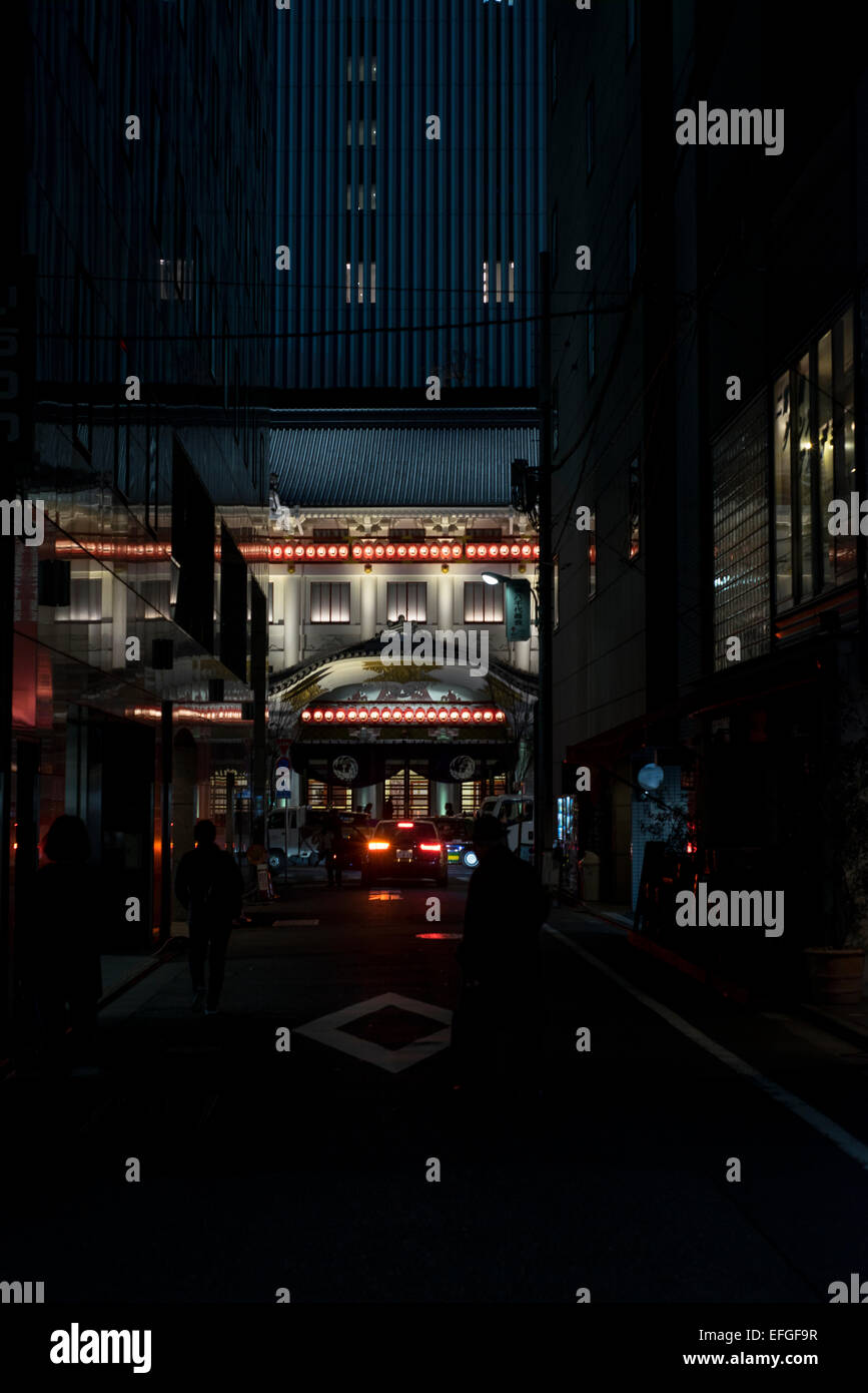 View of Kabuki-za theatre at night from dark alley in Ginza, Tokyo, Japan - Stock Image