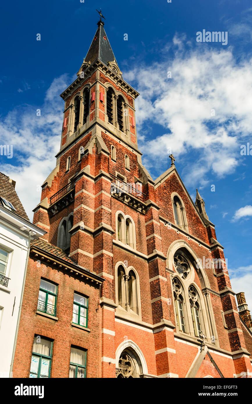 Bruges, Belgium. Image of Sacred Heart church in Brugge, Flanders. Flemish Jesuit religious architecture. - Stock Image