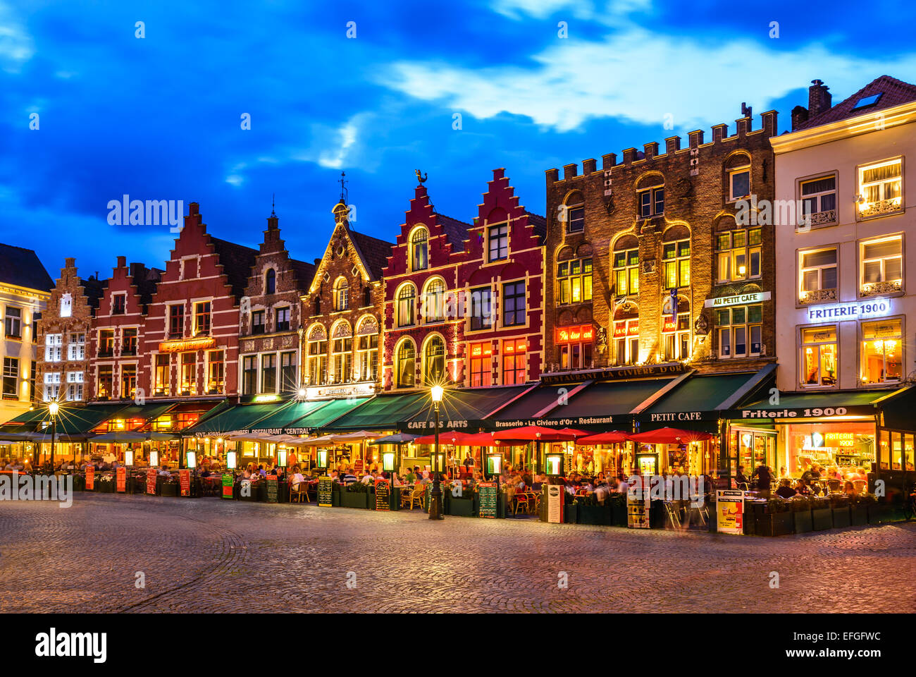 Bruges, Belgium. Night image north side of Grote Markt (Markt) with enchanting street cafes. Stock Photo