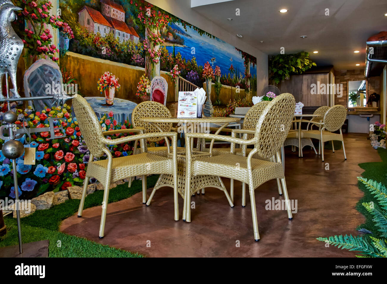 Italian restaurant interior with feature colourful wall mural of