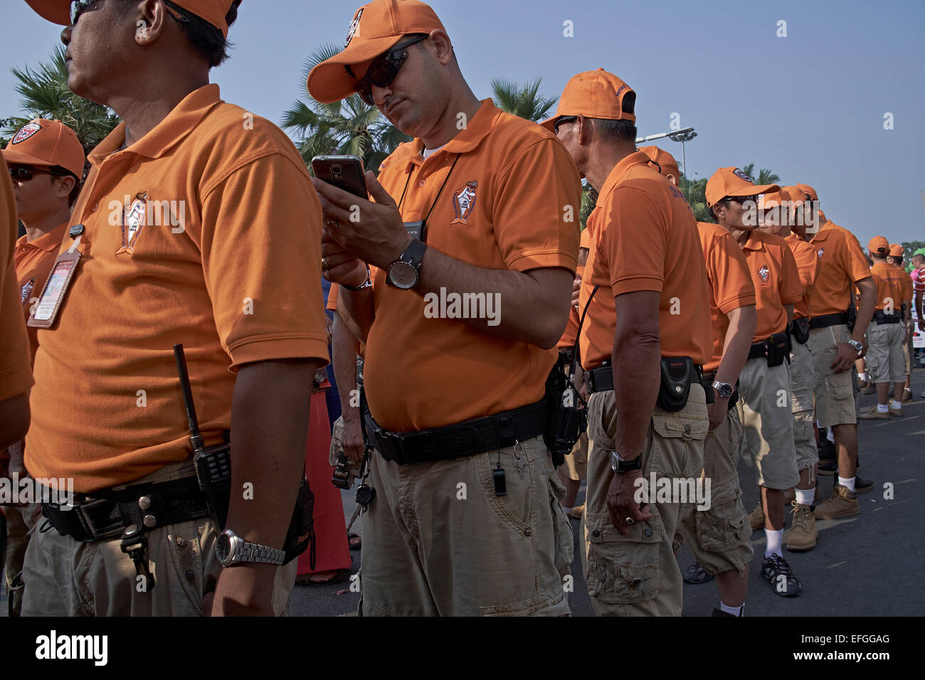 Distinctive orange dress code of the tourist police force in Pattaya Thailand S. E. Asia - Stock Image