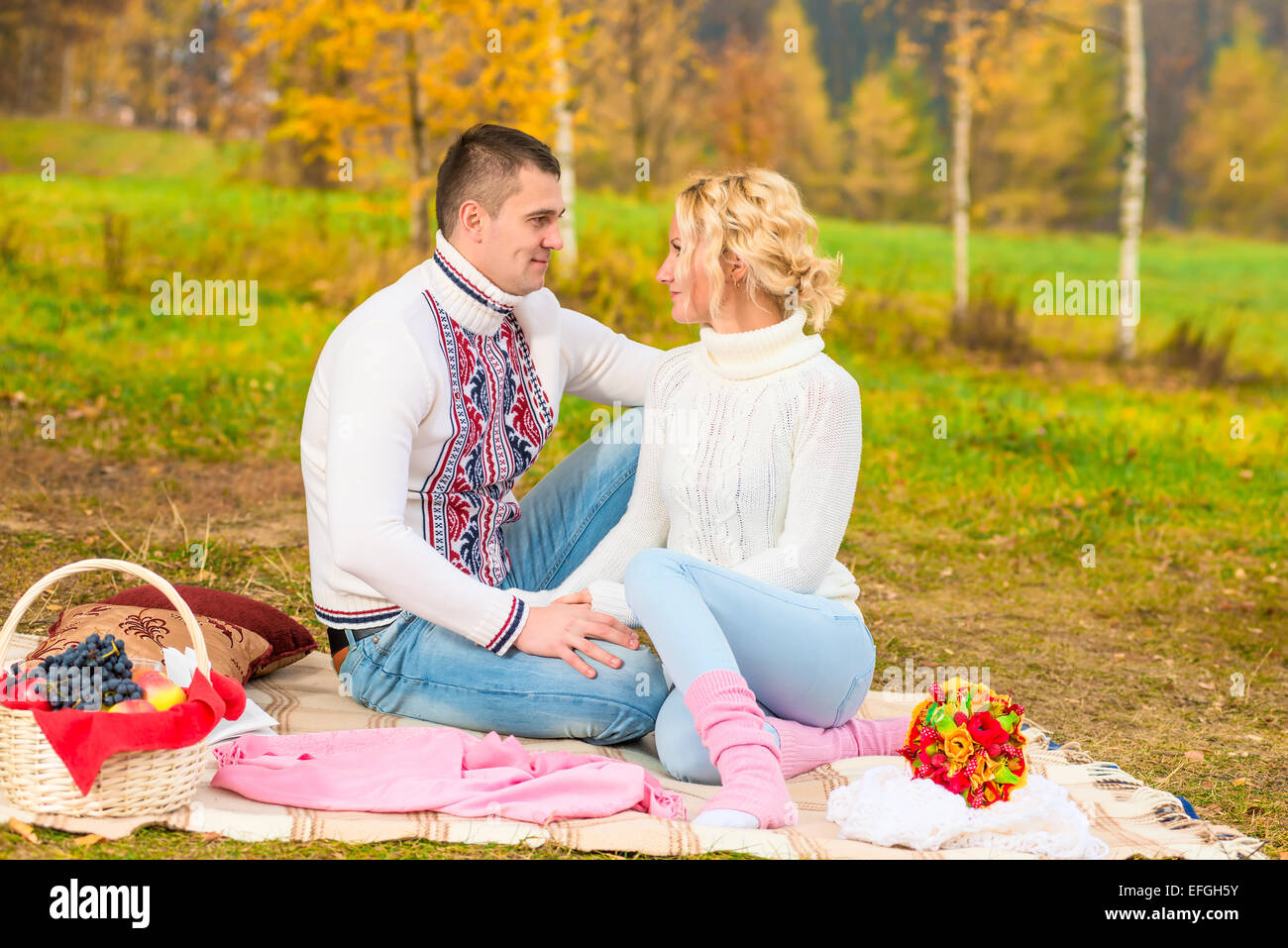 married couple looking into each other's eyes in the park - Stock Image