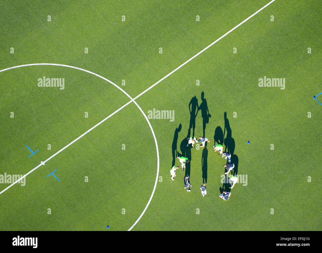 Football team, football players doing warm-up exercises, aerial view, Billtal Stadium, Hamburg, Germany - Stock Image