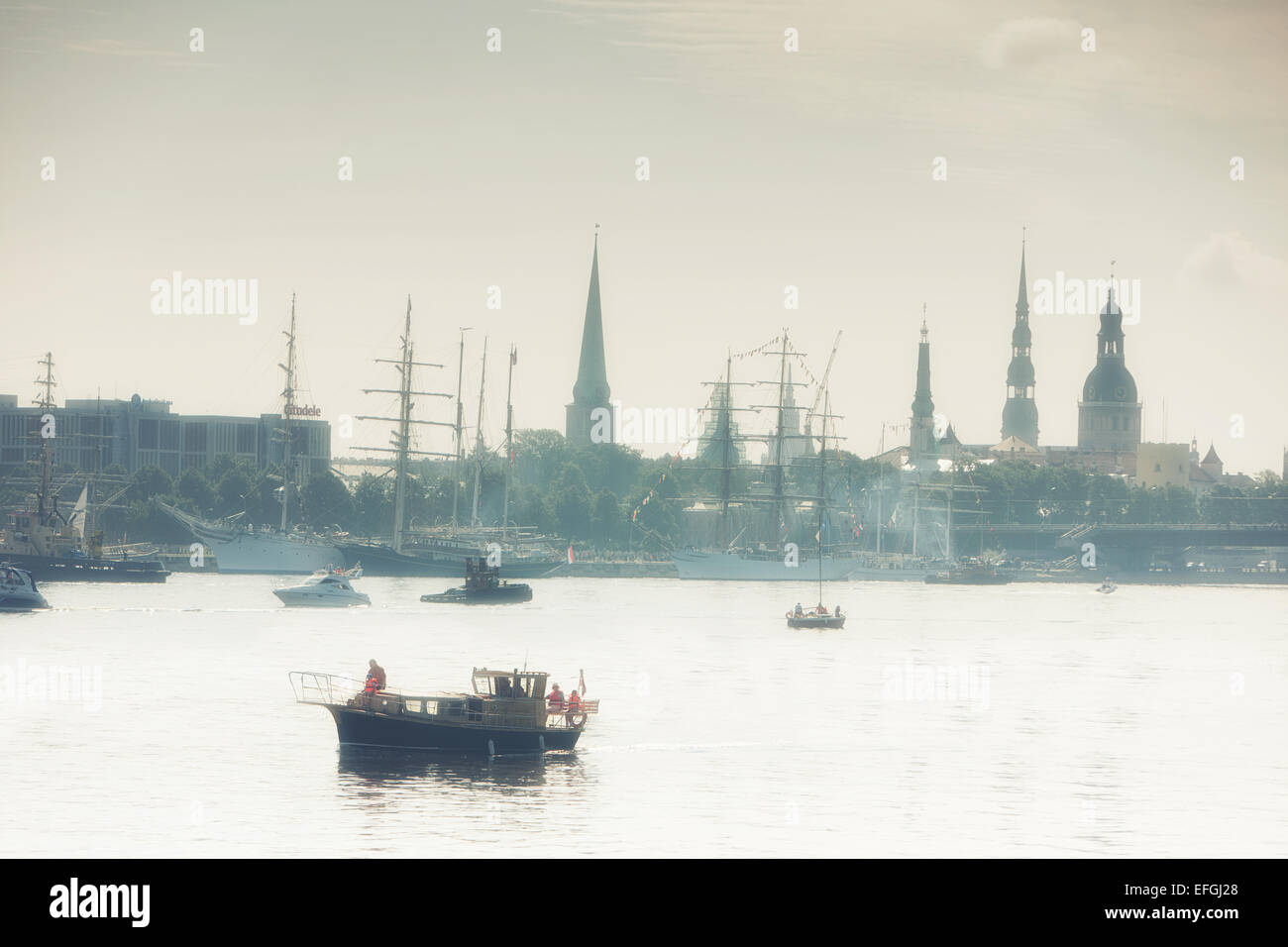 Regatta on the background of the Old Town in the morning. Riga, Latvia - Stock Image