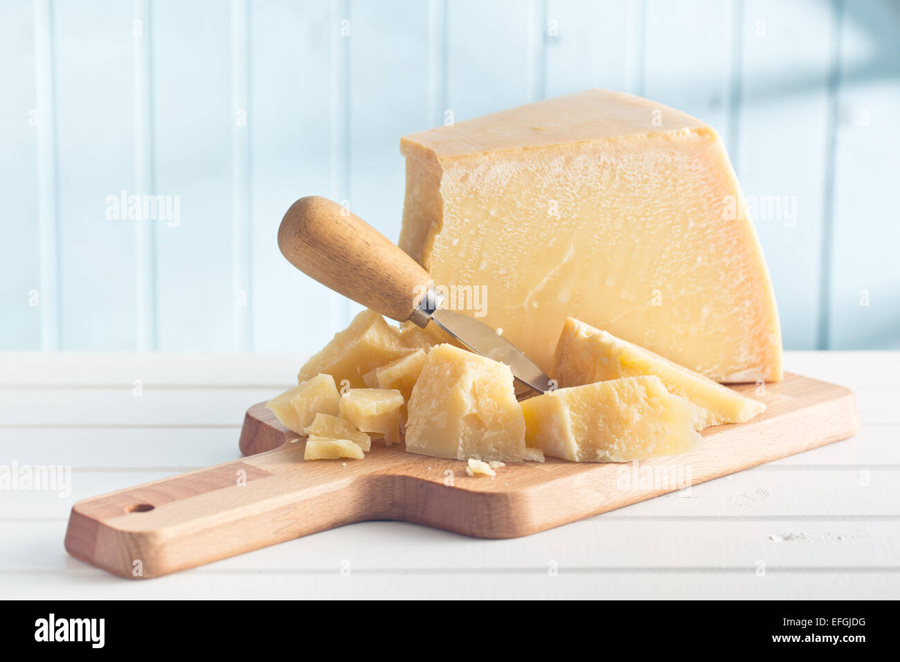 the parmesan cheese on cutting board - Stock Image