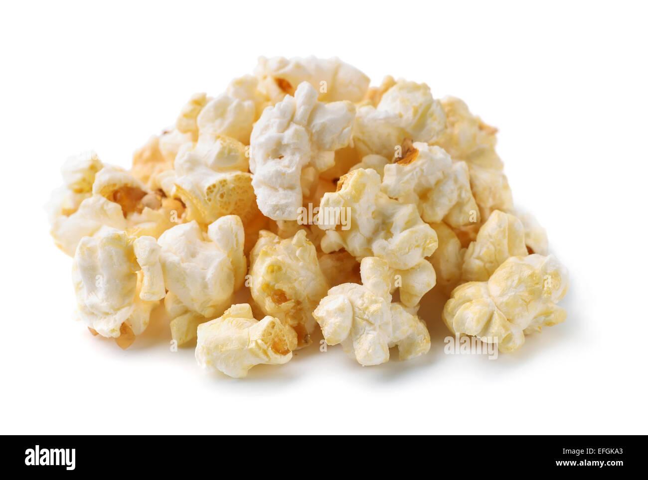 Heap of fresh popcorn isolated on white - Stock Image