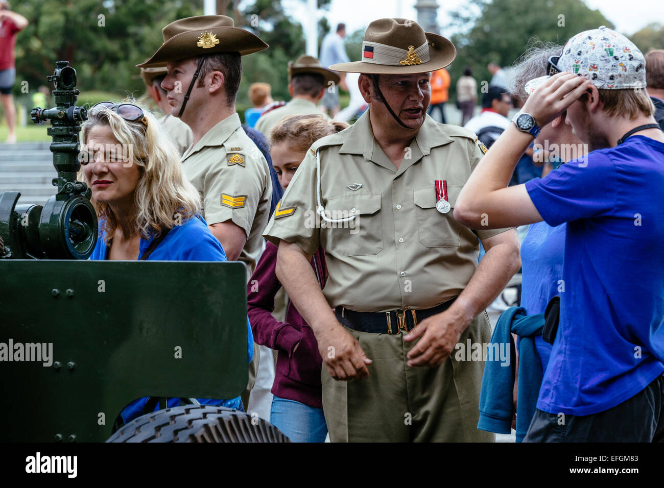 People mingling with soldiers on lower forecourt of Shrine of Remembrance, Melbourne, following Australia Day 21 - Stock Image