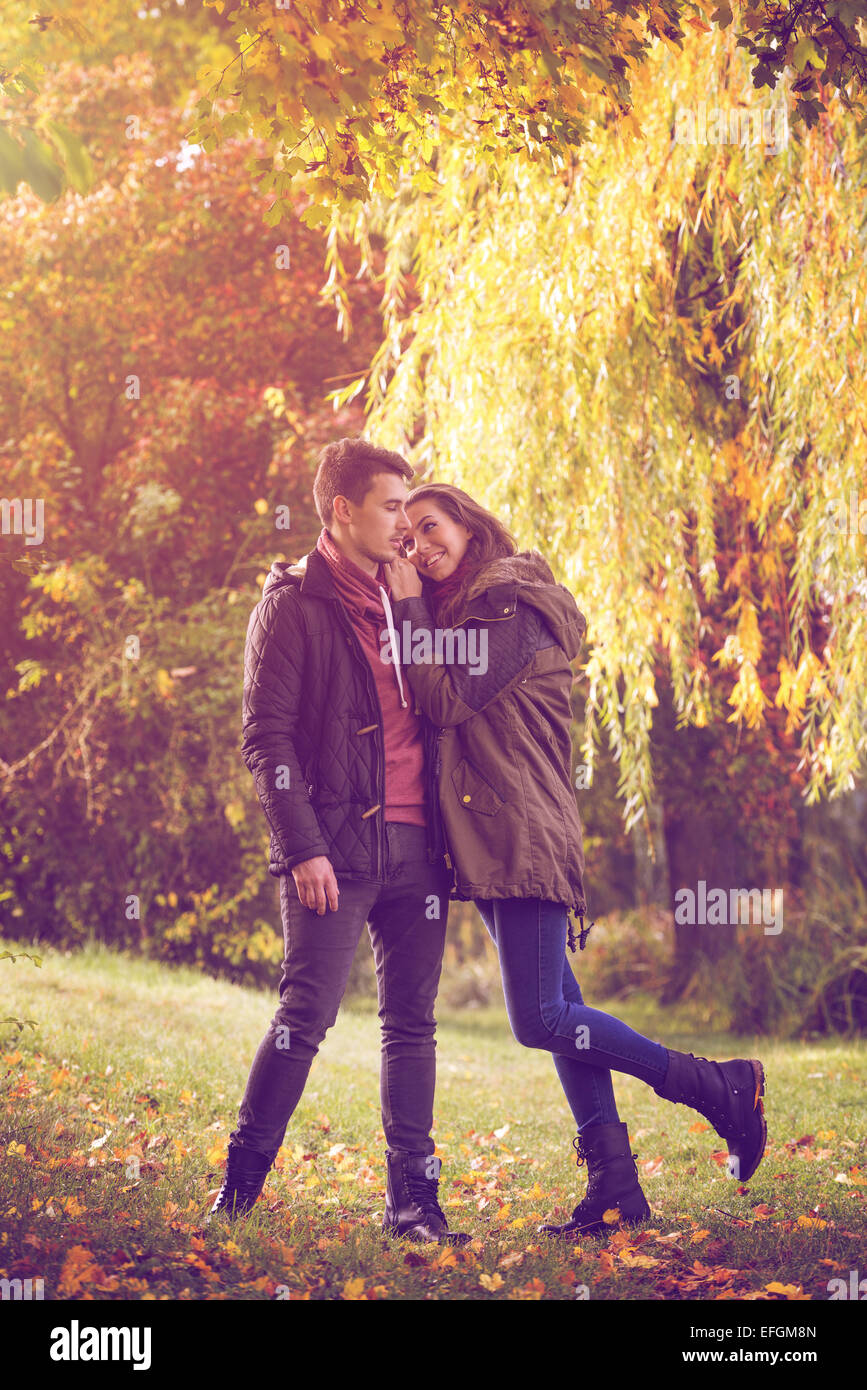 Couple embracing on colorful autumn forest - Stock Image