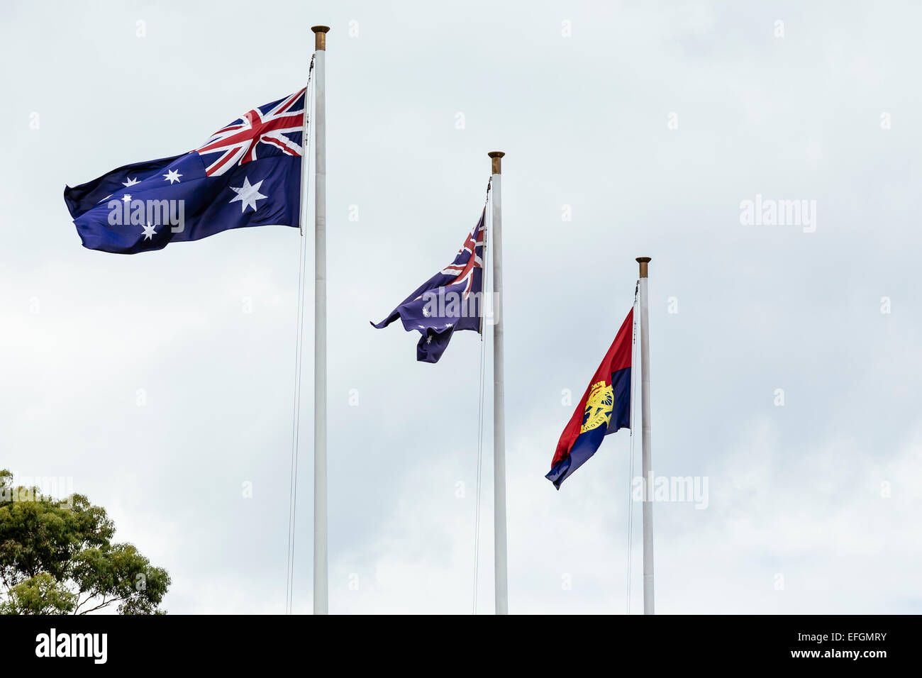Australian, Victorian and RSL flags flying at Shrine of Remembrance, Melbourne, Victoria, Australia - Stock Image