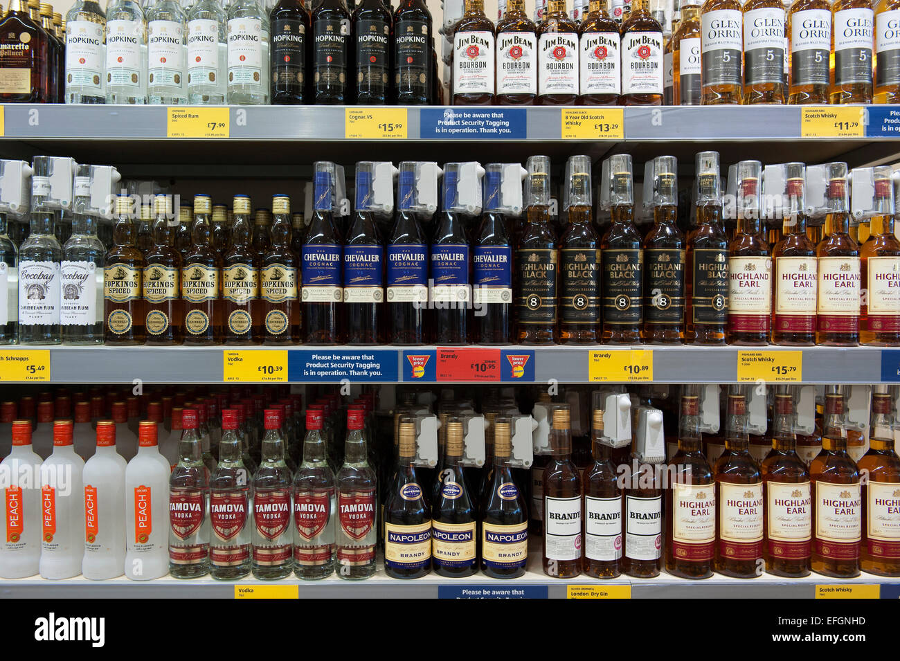 Bottles of cheap alcohol including brandy, whisky and vodka on shelves in a UK budget supermarket. - Stock Image